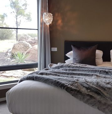 Relax in a luxurious bed with throws at Alure Stanthorpe